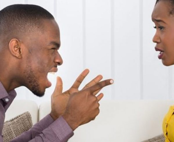 young man yelling at depressed woman