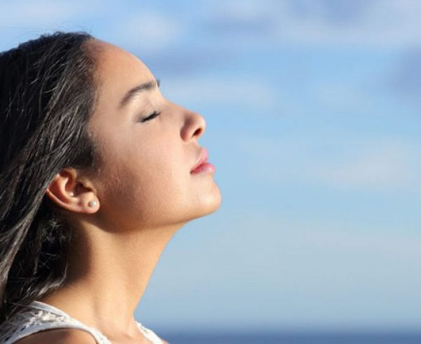 Young Woman practising Meditation Outdoor